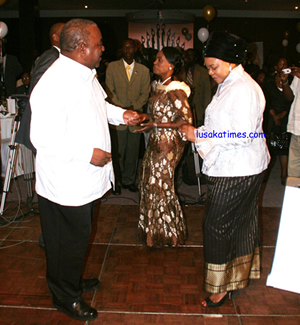 President Rupiah Banda, First Lady Thandiwe (centre) and Mrs Maureen Mwanawasa dancing during the Cathedral of the Holy Cross co-operate partnership ball in Lusaka on Friday night.