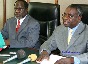 Foreign Affairs minister Kabinga Pande (r) and his counterpart from Defence George Mpombo during a press briefing on allegations that Zambia and Botswana are planning to invade Zimbabwe