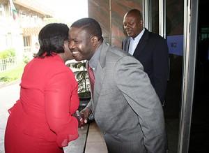 Zambian Breweries PLC corporate Affairs manager Chibamba Kanyama hugs Gender minister Sara Sayifwanda as managing director Pearson Gowero looks on before a seminar on women entrepreneurship in Lusaka
