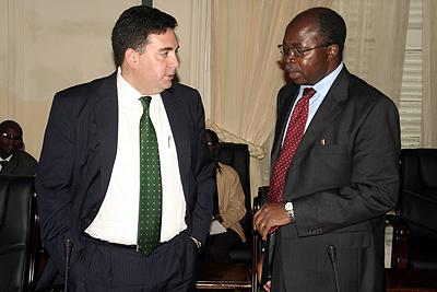 Millenium Corporation vice president Darius Teter with finance minister Situmbeko Musokotwane before meeting President Rupiah Banda at State House