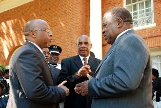 Nevers Mumba (L) with former president Rupiah Banda