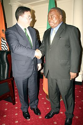 President Rupiah Banda with Millenium Corporation vice president Darius Teter at State House