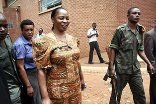 POLICE officers ushering Regina Chiluba to a van before being ferried to Lusaka Central prison or Chimbokaila after a conviction by a Lusaka magistrate Court