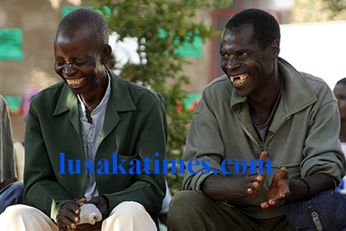 Split your sides with laughter... Two men laughing off jokes from a couple of clowns in Nyimba