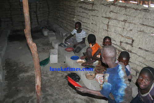 Meal time... Pupils at Kasima basic school having a meal under the school's feeding programme