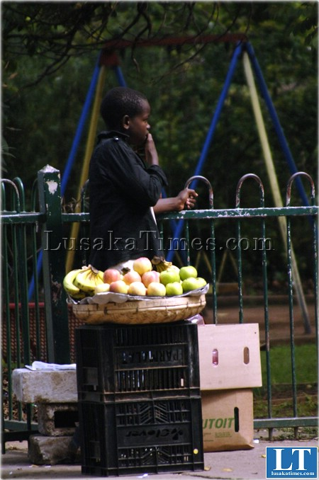 An unidentified child selling apples at Longacres bus station