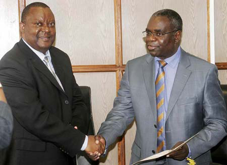 Foreign Affairs Minister Kabinga Pande receives credentials from new Africa Development Bank Country Representative Freddie Kwesiga at Ministry of Foreign Affairs in Lusaka recently