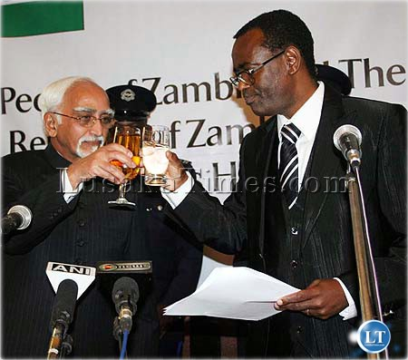 Mr George Kunda with one hand clutched to a speech proposes a toast to vice president of India Hamid Ansari during a State banquet in Lusaka