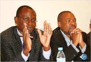 Press Association of Zambia vice president Amos Chanda  (left)