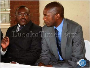 man of the moment...Director of Public Prosecutions Chalwe Mchenga (l) listens Justice deputy Minister Todd Chilembo after launching a lift at the ministry of justice
