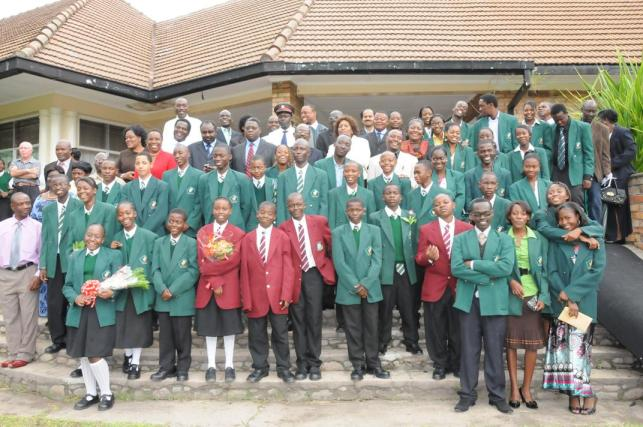 File:Copperbelt Permanent Secretary Villie Lombanya with KCM and Government Officials and the students who received the KCM scholarships