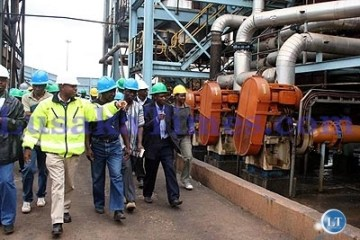 File: Zambia sugar Corporate affairs Manager Lovemore Sievu takes shareholders on a conducted tour of the sugar plant in Mazabuka
