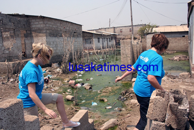 Some officials from UNICEF inspect houses that were flooded in Lusaka