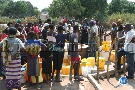 Chibolya compound women  residents gathered at the borehole to find solution to the water problem that has hit  Itezhi-Tezhi district