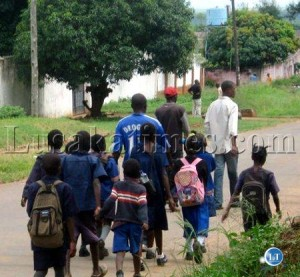 Some adults escorting pupils going to school