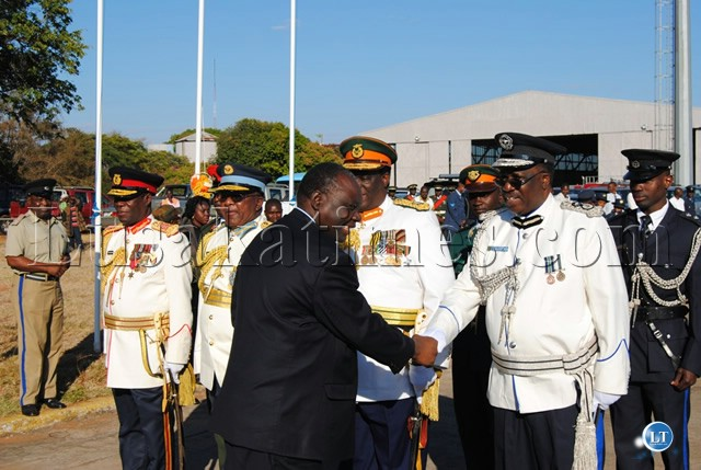DEFENCE Minister Kalombo Mwansa greets the Service Chiefs upon arrival at the ZAF Livingstone Air Base for the Commissioning Parade