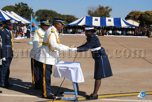 PRESIDENT Banda hands awards the Sword of Merit to 2nd Lieutenant Enala Pondani the only female since 1986 to receive the prestigious award