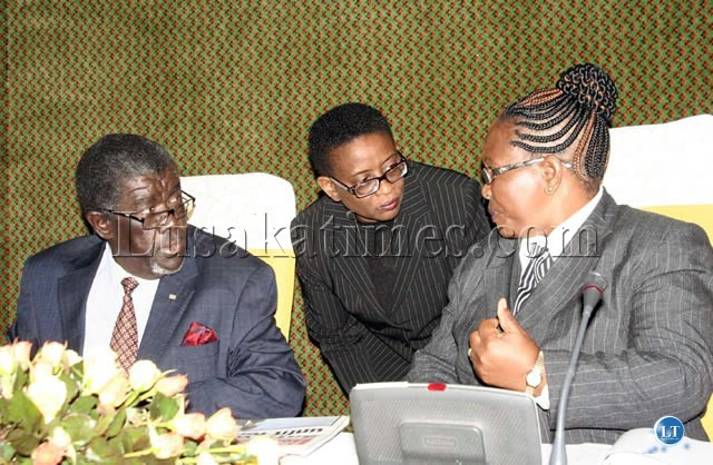 Electoral Commission of Zambia (ECZ) Chairperson Irene Mambilima (right) consults with ECZ Director Priscilla Isaac (center) and ECZ Commissioner Joseph Jalasi