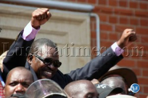 Patriotic Front Secretary General Wynter Kabimba waves to people at the inauguration of President Michael Sata