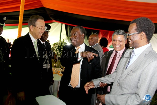 Ban Ki Moon, Former Vice President George Kunda and President Michael Sata share a light moment at State House while Given Lubinda looks on1
