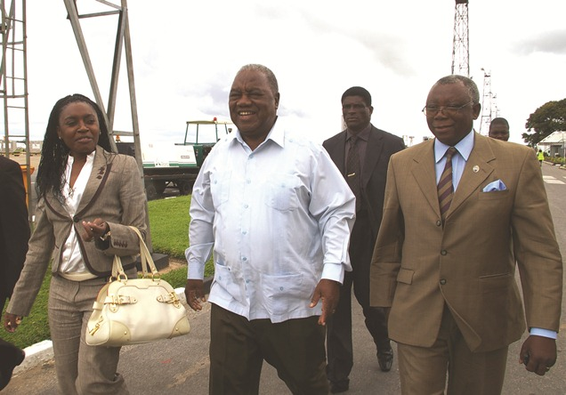 Former republican president Rupiah Banda and his wife Thandiwe walk towards the plane enroute to the United States of America on Wednesday March 21, 2012. Mr. Banda has been invited by Boston University as Guest Lecturer