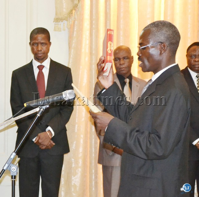 FILE: Chairperson of a tribunal set to probe three suspended judges, Justice Lovemore Chikopa, takes oath before President Michael Sata at State House