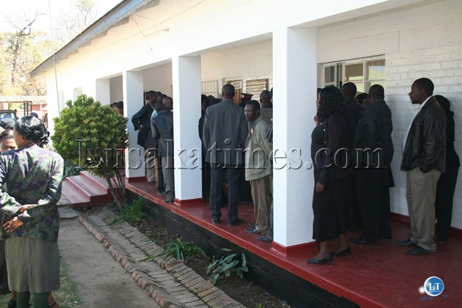 Civil Servants wait for Central Province Permanent Secretary Inutu Suba to come out of her office at the provincial administration offices in Kabwe
