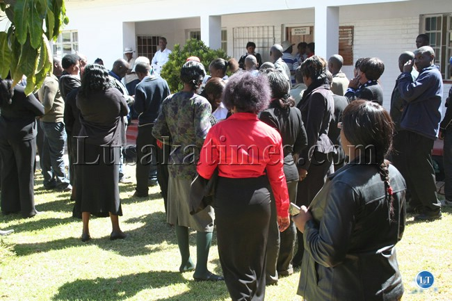 Civil Servants wait for Inutu Suba to come out of her office at the provincial administration offices in Kabwe