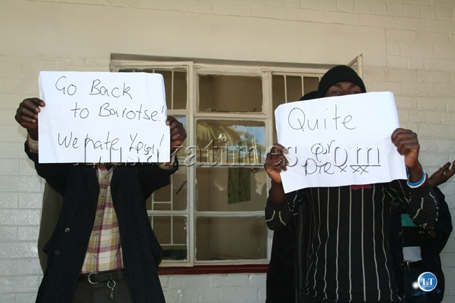 Civil servants with placards denouncing Central Province permanent secretary Inutu Subu at the Kabwe government offices