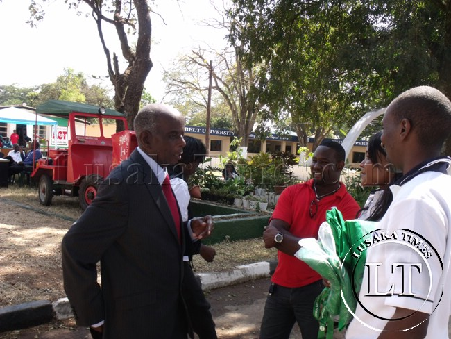 Soccer comentator Deniss Liwewe captured chatting with youths at the trade fair in Ndola.