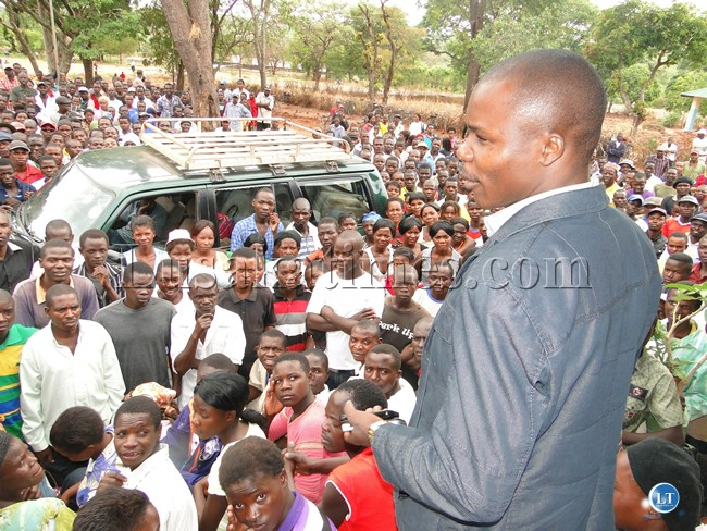 Muchinga province deputy permanent secretary Jewis Chabi addressing hundreds of job seekers who stormed the office of the district commissioner (DC ) Evelyn Kangwa demanding to know when the construction works at the new provincial administration site in the district would commence so that they can be employed