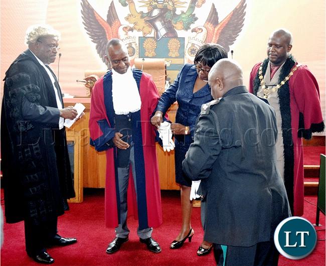 President Michael Sata's son Mulenga Sata putting on the Deputy mayor attire after he won the deputy mayoral election