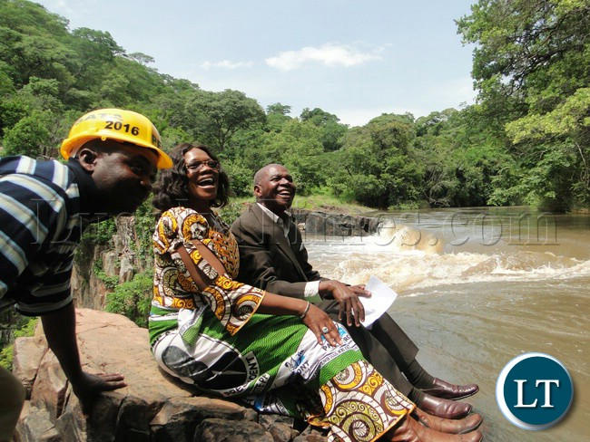 Tourism Minister Silvia Masebo pose for a photo with Northern Province Minister Col. Gerry Chanda relaxing at Kalambo falls in Mbala district of Northern Province