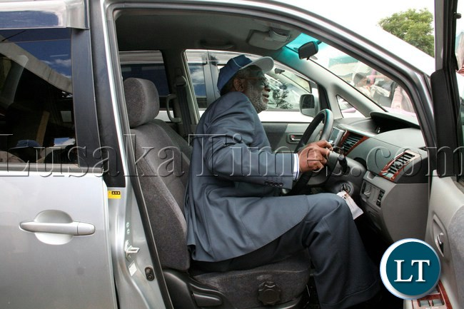 Labour Minister Fackson Shamenda flanked by ZNUT President Henery Kapenda (l) and ZNUT General Secretary Newman Bubala (r) checks the vehicles on the occasion of the handover of vehicles to Provinces and Women's Committee by ZNUT at ZNUT Offices in Lusaka,