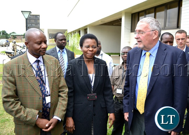 Vice President Guy Scott talks to Oxfam Zambia Director Nellie Nyang'wa and Oxfam Deputy Regional Director Southern Africa Elijah Adera at the New Government Complex in Lusaka