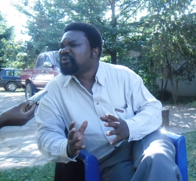 Dr Canisius Banda talking to journalists