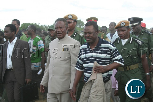 President Michael Sata walking to the rally arena upon arrival at meembe basic school grounds to drum up suport for the patriotic front candidate for the kapiri mposhi bye election Eddie Musonda , with his is (PF) general secretary Wynter Kabimba in lukanga swamps chipepo ward.