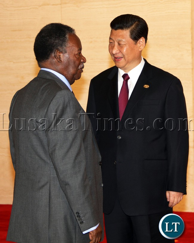President Micheal Sata greets Chinese President Xi jinping at the BOAO Forum for Asia Annual conference in Hainan province of China before the Summit Started picture by Eddie Mwanaleza/ Statehouse 07-04-2013.