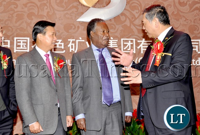 President Sata listens to China Nonferrous Metal Mining (Group) Co . Ltd ( CNMC ) president Luo Tao as Chinese Ambassador to Zambia Zhou Yuxiao looks on on arrival at CNMC head office in Beijing China where he addressed Chinese Investors on April 11,2013-Picture by THOMAS NSAMA