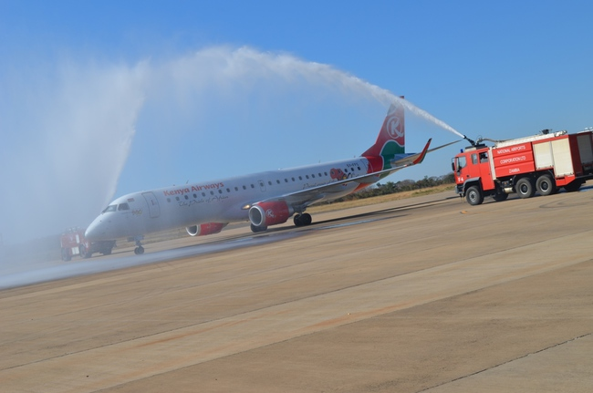 Fire engines splashing water on Kenya Airways aircraft to celebrate the airline's inaugural direct flights on Nairobi-Livingstone route at Harry Mwaanga Nkumbula International Airport in Livingstone