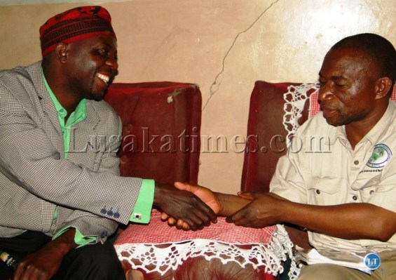 Chief Chitoshi greets Northern Province Minister Obious Chisala when called on him at his palace in Mporokoso during his familiarization tour recently. The Chief expressed disappointment at the wrangles at Senior Chief Tafuna in Mpulungu district