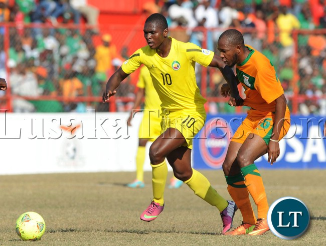 David Manjere of Mozambique challenged by Munthali Christopher of Zambia during the Cosafa Cup Quarter Finals match between Zambia and Mozambique on the 14 July 2013 at Nkana Stadium, Zambia ©Muzi Ntombela/BackpagePix