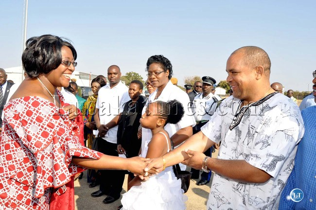 First Lady Dr Christine Kaseba being welcomed by PF Livingstone Member of Parliament (MP) Lawrence Evans  on arrival at Harry Mwanga Nkhumbula International Airport for the launch of Community Health Tourism on July 31,2013-Picture by THOMAS NSAMA