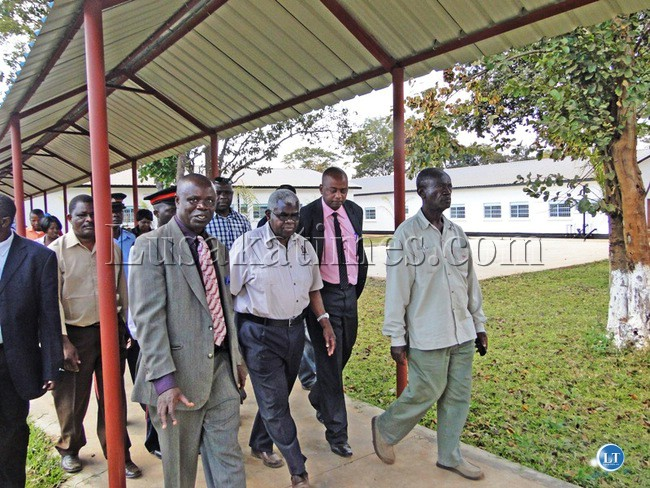 Deputy Secretary to the Cabinet Peter Kasanda (middle)with his entourage during a conducted tour of the New Lufwanyama District Hospital