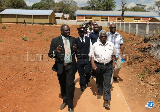 Deputy Secretary to the Cabinet Peter Kasanda with his entourage during a conducted tour of the New Lufwanyama Secondary School
