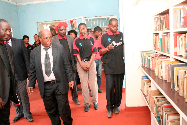 Zambia Library Service Chief Librarian Bwato Robinson (l) shows Education Minister Dr. John Phiri (c) the Mongu Libraryduring the Launch of the National Libraries Week at Mongu Librabry in Mongu
