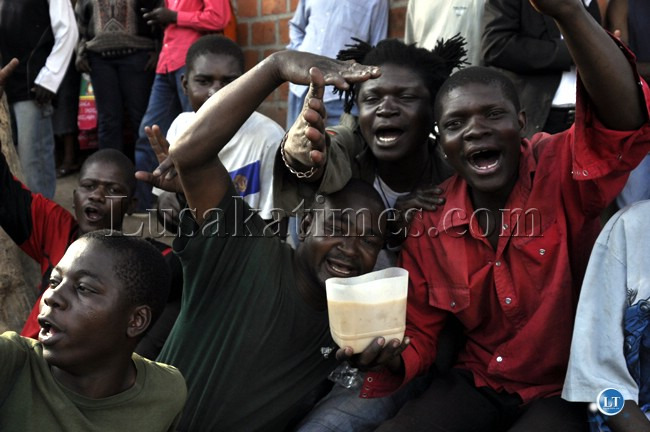 Some youth from Mandevu township drinking beer