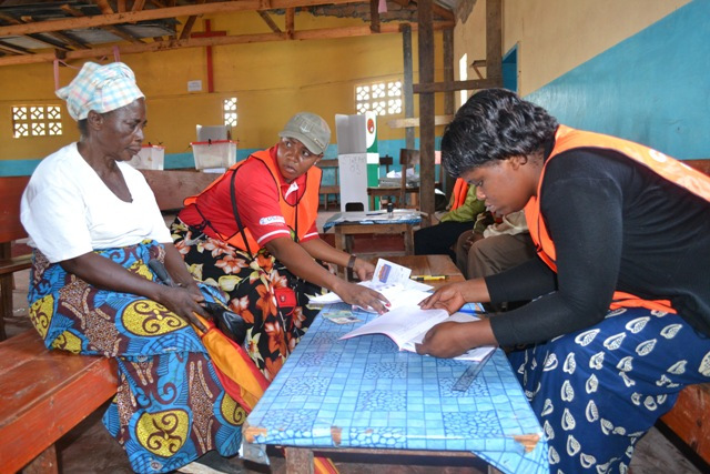 ELECTORAL Commission of Zambia (ECZ) official Mukiti Lukonga (standing) checking voting proceedings at St Clement's Polling station during the Mansa Central by-election