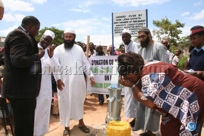 Deputy minister of community development mother and child health drinks water from the borehole donated by the muslim social and welfare trust
