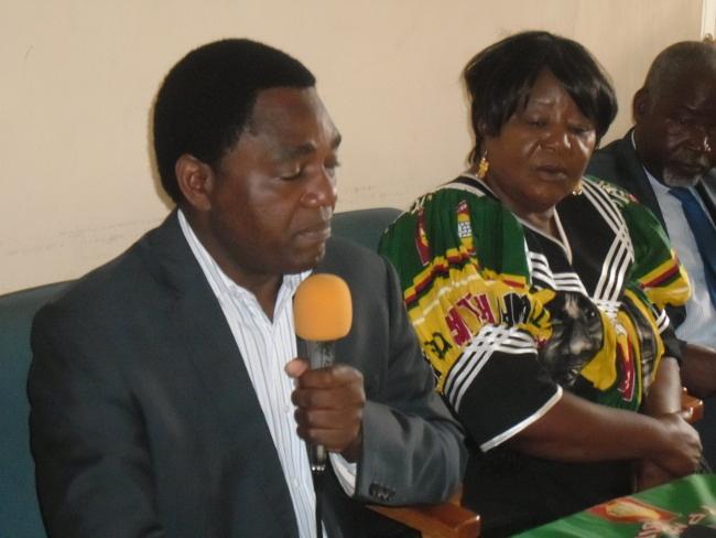 Hakainde Hichilema addressing the media